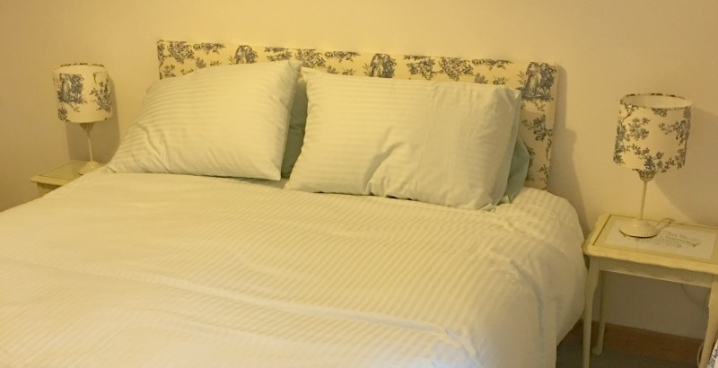Bed with lamps